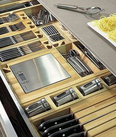 This organised kitchen drawer has a divided section for every piece so that all the essential are organised and easy to find!