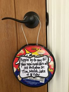 Moved into our wonderful neighborhood & thought this would be a fun lil gift for new neighbors! The Jiffy Pop has a built-in handle to fit over the doorknob