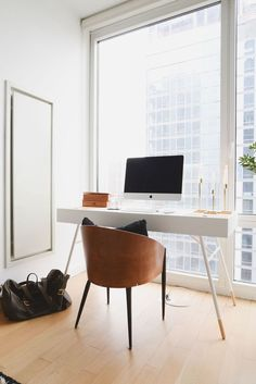 A midcentury desk—paired with a vintage barrel chair—makes for a discreet home…
