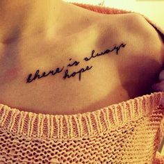 Clavicle tattoo saying 'there is always hope' on Lina Becker.