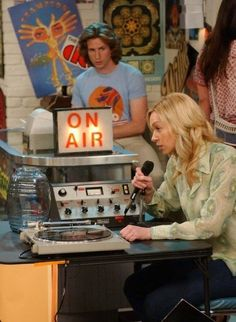 "Randy (Josh Meyers) watches Donna (Laura Prepon) as she experiences minor difficulties raising money for children's books in the ""Who Needs You"" #that70sShow"