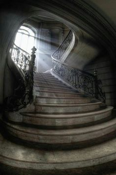 The interior of the old place was as cold as a tomb, she thought, waiting at the foot of the stairs. - THE GHOST