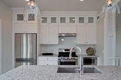 """This looks to me like 15"""" cabinets stacked on 30"""" cabinets with 9"""" of crown molding on top (9 foot ceilings).  Exactly what I want.  Love the gray Blanco sink and the quartz counters."""