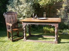 Early 17th century oak centre table.  West country, Somerset. With lunette carved rail scrolled spandrels over turned legs united by a box stretcher.