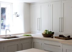 Such restrained colours, perfect proportions, great use of space. Plain English Bespoke Handmade Kitchen - Long House 2