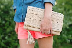 "Urban Expressions ""Kennedy"" beige laser-cut clutch // Monogrammed chambray button-down - AmyAnneApparel on Easy // Pink shorts - JCrew"