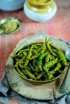 Hari Mirch Ka Achar Recipe or Green Chilli Pickle Recipe - Hari mirch ka achar or green chili pickle goes very well with Indian meals. Chilli Pickle Recipe, Indian Pickle Recipe, Green Chilli Pickle, Chilli Food, Pickles Recipe, Veg Recipes, Indian Food Recipes, Vegetarian Recipes, Cooking Recipes