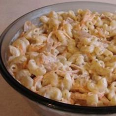 TUNA MACARONI SALAD 3 cups macaroni 1/3 cup Italian-style salad dressing 1/2 cup sour cream 1 cup mayonnaise 1 onion, chopped 2 stalks celery, chopped 1/2 teaspoon garlic powder 1 teaspoon salt 1/2 teaspoon ground black pepper 1 (6 ounce) can tuna, drained Cook pasta in a large pot of boiling salted water until done. Drain. Marinate macaroni in Italian dressing for 2 to 3 hours or overnight. Mix sour cream, mayonnaise, onion, celery, garlic powder, tuna, and salt and pepper into macaroni. Chill.