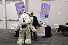 Mark Ress of Blitz Media Marketing having some fun posing for picture #4 with the Money Bear at the I.E. Largest Mixer 2011