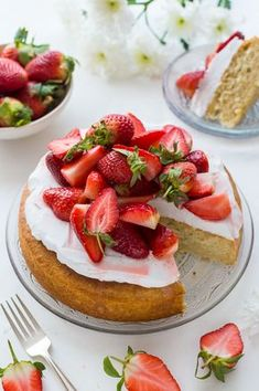 Vegan lemon almond cake with coconut whipped cream and macerated strawberries - a light, moist vegan lemon and almond cake topped with a cloud of coconut whipped cream and sweet macerated strawberries. The perfect cake for Spring!