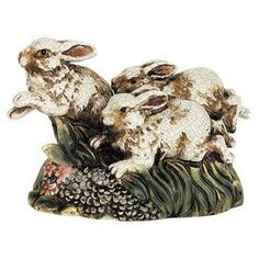 """Ceramic rabbits statuette with a crackled finish.      Product: DecorConstruction Material: CeramicColor: MultiFeatures: Charming designDimensions: 8.5"""" H x 13.5"""" W x 5.5"""" D"""