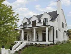 """Home Exterior Paint Color: Siding is James Hardie Artisan 4″ lap siding in Benjamin Moore White Dove OC-17.  Black Windows: Marvin Integrity – Each window is 30″ x 72″ and mulled together, so 60″ wide in total.  The front porch lights are Chart House – Elsinore Hanging Lantern in Black.  Rood is GAF Timberline """"Black"""".  Spacecrafting Photography. Charlie & Co. Design, Ltd. Kroiss Development, Inc."""