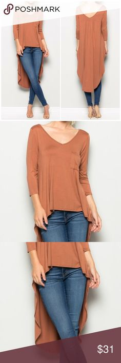 3/4 Sleeve Rust Hi Low Tunic Top 3/4 Sleeve Rust Hi Low Tunic Top featuring a V neckline. 95% Rayon 5% spandex. Perfect to pair with leggings, jeans or shorts. Fits true to size Fabfindz Tops Tunics