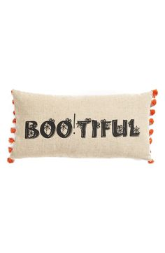 Bright tassels add festive flair to this seasonal accent pillow stamped with spooky graphics.