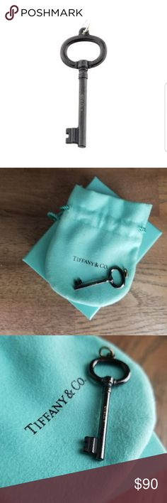 Tiffany and co black titanium oval key pendant Tiffany and co black titanium oval key pendant. NIB. Tiffany & Co. Jewelry Necklaces