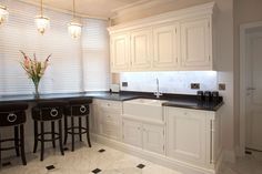 Traditional bespoke kitchen with brass lanterns and double belfast sink  | JHR Interiors