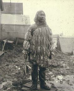 Inuit man wearing a sea lion gut parka. Nome, Alaska. 1900.