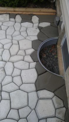 Introduction Many of you have wondered about the patio shown in the DIY Barrel Stove Outdoor Furnace pictures. In this topic, I will discuss how I built the patio using a concrete walkway maker for… Concrete Patios, Poured Concrete Patio, Concrete Walkway, Rock Walkway, Driveway Pavers, Concrete Molds, Concrete Crafts, Brick Pavers, Patio Steps