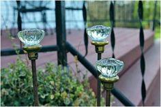 Glass knobs as garden stakes.