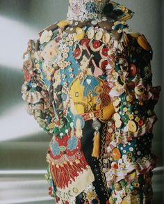 Used - 'Mexican Jacket' 1989. Labor artist Mario Rivoli made from leftover trimmings and found objects. Camouflaged among the buttons, ribbons and lines, with a closer look observant can notice two human figures, portraying a couple wearing typically Mexican costumes.