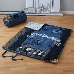 Storybook Double Sleeping Bag. Appliqued and embroidered storybook cover on the outside and playful printed woodland scene on the inside. Only at The Land of Nod.