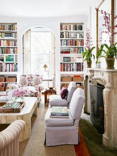 Modern meets classic and traditional in this living room with lots of bookshelves // Lauren McGrath's New York apartment