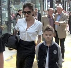 Fashion icon and former Spice Girl Victoria Beckham seen with her son Romeo arriving at the Gare Du Nord train station in Paris before heading to the Chanel Store