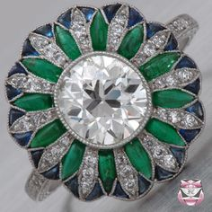 Platinum Ring Setting from Fay Cullen. -- Emeralds, sapphires and a lovely diamond center stone. ~gorgeous~
