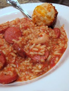 Slow Cooker Jambalaya.   1 pound skinless, boneless chicken breast halves - cut into 1 inch cubes  1 pound smoked turkey sausage, sliced  1 (28 ounce) can diced tomatoes with juice  3 Tbsp dried minced onion flakes  1 cup chicken broth  2 teaspoons dried oregano  2 teaspoons dried parsley  2 tsp minced garlic  2 teaspoons Cajun seasoning  1 teaspoon cayenne pepper  1/2 teaspoon dried thyme  white rice or instant rice (2 packs Uncle Ben's Ready Rice).  More info on site.