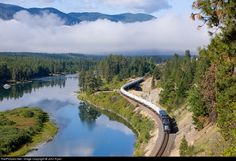 """Montana Rail Link's """"Day Gas"""" turn has just started its return journey to Missoula as it rolls along the Clark Fork River near Thompson Falls, MT."""