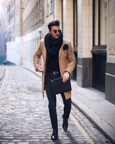 Beige over coat with black shirt and pants