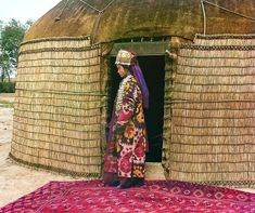 Full-length profile portrait of a woman, possibly Turkman or Kirgiz, standing on a carpet at the entrance to a yurt, dressed in traditional clothing and jewellry. The Final Years of Pre-Soviet Russia, Captured in Glorious Color circa 1909  | Raw File | Wired.com