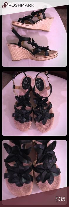 """BOC Born Concept Black Leather Floral Wedges Sz 10 Gently Worn a Few Times; Minor Signs of Gentle Wear; BOC Born Concepts Black Leather Floral Front Wedges! Incredibly Cute and Comfortable with BOC's Hallmark Cushioned Sole! Fun, Flirty, and Girly! Perfect for Summer! Stylish Wedges that Don't Sacrifice Comfort! Size 10; Adjustable Buckle Ankle Straps; Approx. 4"""" Wedge; Gold Wedge Version is Also Available in my Closet! Born Shoes Wedges"""