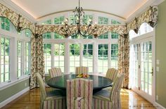 love the sunroom but not the window treatments. ll