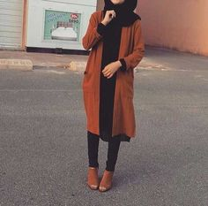 Pinterest: @eighthhorcruxx. Tan and black outfit. Tan coat and ankle boots and black jeans, top and hijab.