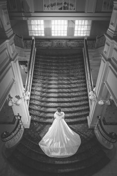 An elegant wedding portrait on the staircase at Disney's Grand Floridian Resort & Spa. Photo: Jacob, Disney Fine Art Photography