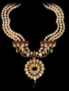 Kundan Necklace | Three stranded necklace. South India, late 19th centruy design. A large pendant set with diamonds, rubies and an emerald in kundan technique. The pendant is attached with three strands of cultured pearls.