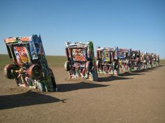 Cadillac Ranch.......WE WALKED OUT HERE (FROM THE HIGHWAY) ONE TIME ON OUR WAY TO CALIFORNIA......ARTISTS HAVE PAINTED THEM.........N E A T ............ccp