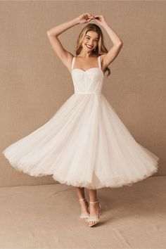 A vintage-inspired midi silhouette gets a chic update for the modern, city hall bride. This flirty gown pairs a full skirt in Swiss dot tulle with a fitted bustier bodice. Pearl studding and wide grosgrain straps add charming detail. Courthouse Wedding Dress, Cute Wedding Dress, Best Wedding Dresses, Bridesmaid Dresses, Casual Wedding, Cocktail Wedding Dress, Free People Wedding Dress, Wedding Bride, Wedding Blog