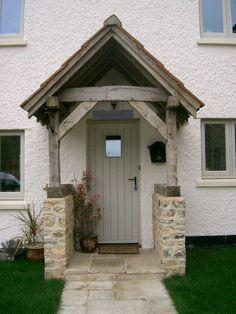 Awesome Oak Front Door So Your House Looks Simple But Awesome Oak Front Door So Your House Looks Simple But Beautiful homedecorideas doordecorations homedesignonabudgetSuper House Front Cottage IdeasSuper House Front Cottage Cottage Front Doors, Oak Front Door, Front Door Porch, Cottage Porch, Exterior Front Doors, House Front Door, Cottage Exterior, House With Porch, Porch Entrance