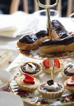 Eclairs, chocolate cream tartlets, strawberry tartlet.