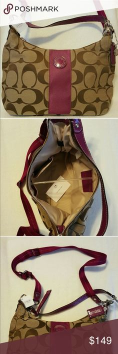 """NWT Coach convertible hobo It has the signature stripe and a rare combination of khaki and berry. The inside has two pouches and a zippered pouch with a pull tag. It zips close with a pull tag. It has a fabric lining. A hangtag and charm are attached. The handle has an 11"""" drop. It's 13""""Lx11""""Hx4.5""""D. Coach Bags Hobos"""