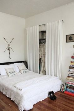 love curtains instead of doors to hide closet...so much softer and whimsical!