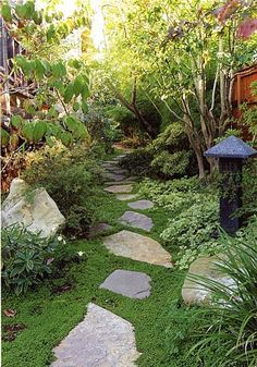 this would be a lot cheaper than paving or making full brick paths. Maybe place a little closer together and plant Creeping Mother of Thyme or other ground cover! Pretty!