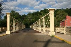 When the weather's nice, we love taking a stroll over Clinton's historic  iron truss bridge and walk into town.