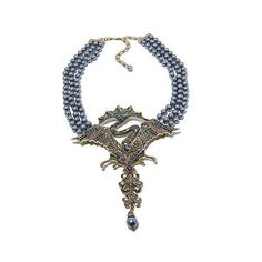 This whimsical drop necklace is straight out of a fairytale! Reminiscent of the costumes from Disney's Maleficent, this necklace's crystal-encrusted focal point is wickedly glamorous.