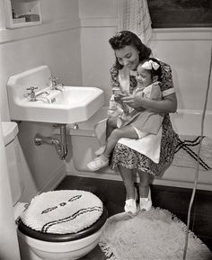 What a charmingly sweet image of a 1940s mom and her little girl (it's so cute how they're both wearing bows in their hair).