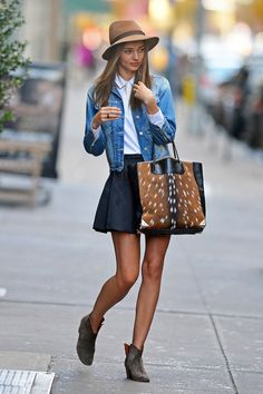 Black skirt, white blouse, denim jacket and brown boots, hat and bag, Mirnda kerr style