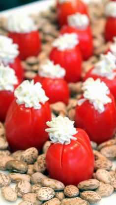 Goat Cheese and Mint Stuffed Cherry Tomatoes  Little beautiful gems.  Sweet Cherry Poppers, sliced and stuffed with Creamy Herbal Goat Cheese.  Made pretty for any bring and share occasion.  Simple, only a few ingredients and ALWAYS A CROWD PLEASING PLATE!