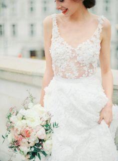 New York style floral beaded Eva Poleschinski wedding dress: http://www.stylemepretty.com/2016/12/15/best-wedding-dresses-of-2016/ Photography: Melanie Nedelko - http://www.melanienedelko.com/